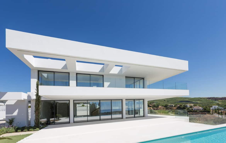 Design villa meteen aan de golf van Los Flamingos, met zicht op zee en de bergen