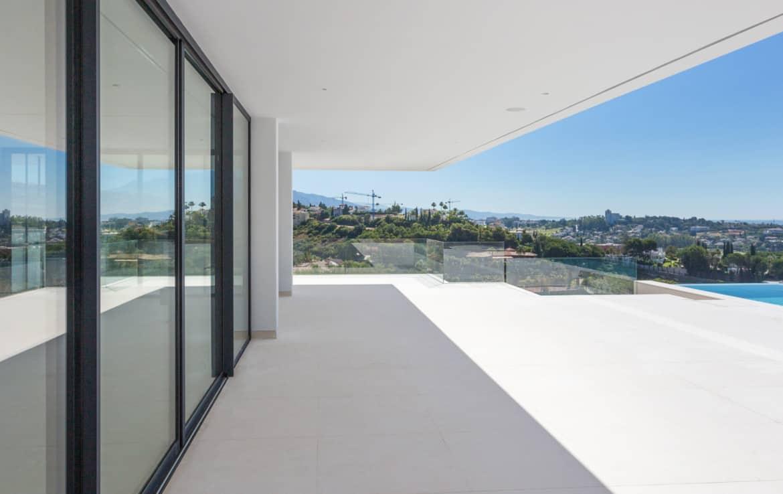Design villa met terrassen die uitkijken op de golf van Los Flamingos, de Middellandse Zee en de bergen