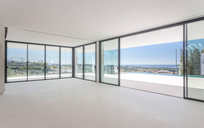 Nieuwe design villa met zwembad, uitkijkend op de golf van Los Flamingos, de Middellandse Zee en de bergen